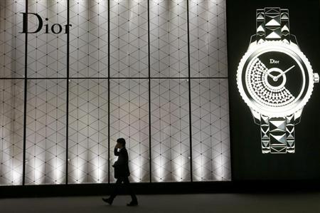 A man walks past the exhibition stand of Dior at Baselworld fair in Basel April 24, 2013. REUTERS/Arnd Wiegmann
