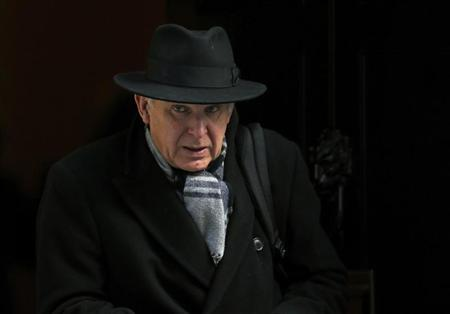 Britain's Business Secretary Vince Cable leaves after attending a Cabinet meeting at Number 10 Downing Street in London March 12, 2013. REUTERS/Andrew Winning