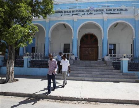 People walk outside Somalia's central Bank in Hamarwayne district, south of capital Mogadishu May 16, 2013. REUTERS/Omar Faruk