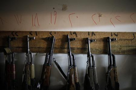Firearms, recently seized by police on the streets of Yemen's capital Sanaa and roads leading to it, are seen stored at a security force base in Sanaa May 5, 2013. REUTERS/Khaled Abdullah