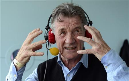 Comedian and presenter Michael Palin is interviewed on BBC Test Match Special during the tea break during the first test cricket match between England and New Zealand at Lord's cricket ground in London May 18, 2013. REUTERS/Philip Brown