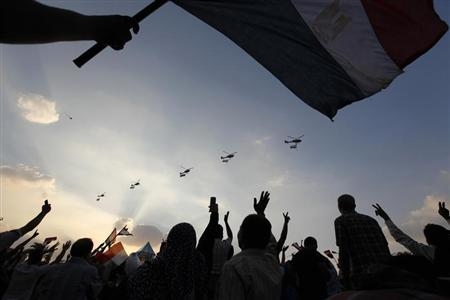 Military helicopters fly above Tahrir Square while protesters opposing Egyptian President Mohamed Mursi shout slogans against him and Brotherhood members during a protest in Cairo July 1, 2013. REUTERS/Mohamed Abd El Ghany