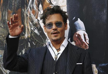 Cast member Johnny Depp waves at the world premiere of ''The Lone Ranger'' at Disney California Adventure Park in Anaheim, California June 22, 2013. The movie opens in the U.S. on July 3. REUTERS/Mario Anzuoni