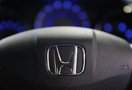 The logo of Honda Motor Co is seen on a steering wheel of a car at the company's showroom in Tokyo April 26, 2013. REUTERS/Yuya Shino/Files