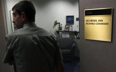A man walks past a doorway at the Fort Worth Regional Office of the Securities and Exchange Commission (SEC) in Fort Worth, Texas June 28, 2012. REUTERS/Mike Stone