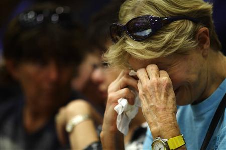 Toni Tennille cries as she listens to Arizona Governor Jan Brewer speak during a news conference at Prescott High School in Prescott, Arizona July 1, 2013. REUTERS/Joshua Lott
