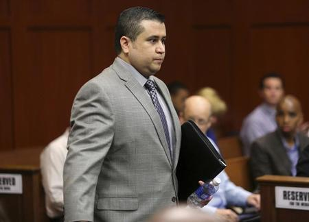 George Zimmerman enters the courtroom during his second-degree murder trial in Seminole circuit court in Sanford, Florida, July 2, 2013. REUTERS/Joe Burbank/Pool