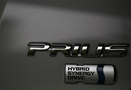 The logo of Toyota Motor Corp's Prius hybrid car is seen on its body at the company's showroom in Tokyo April 17, 2013. REUTERS/Issei Kato