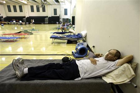 John Irwin, a resident of Peeples Valley who was not able to return to his home due to the Yarnell Hill Fire, lies on a cot at the Yavapai College evacuation center in Prescott, Arizona July 2, 2013. REUTERS/Joshua Lott