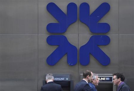 Pedestrians walk past a Royal Bank of Scotland (RBS) branch in the City of London March 6, 2013. REUTERS/Toby Melville