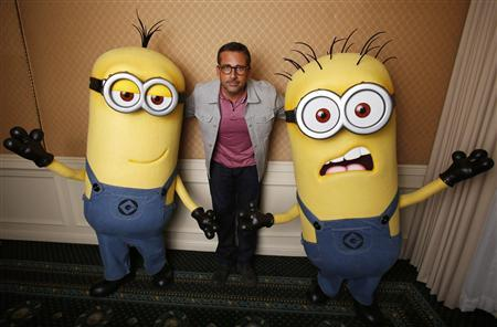 Actor Steve Carell poses with two life-size minion characters while promoting his upcoming movie ''Despicable Me 2'' in Los Angeles, California June 14, 2013. REUTERS/Mario Anzuoni