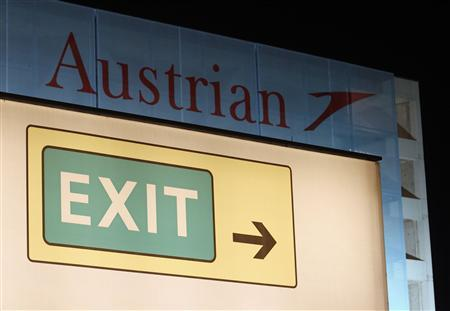 An exit sign is pictured at the Vienna International Airport in Schwechat July 3, 2013. REUTERS/Heinz-Peter Bader