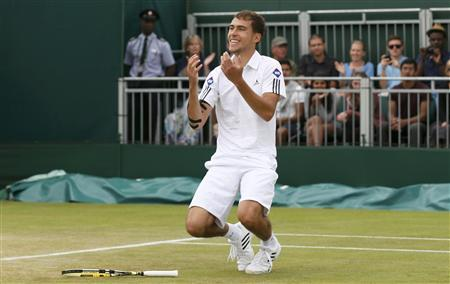 Jerzy Janowicz of Poland celebrates after defeating Jurgen Melzer of Austria in their men's singles tennis match at the Wimbledon Tennis Championships, in London July 1, 2013. REUTERS/Stefan Wermuth