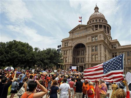 Protesters rally before the start of a special session of the Legislature in Austin, Texas July 1, 2013. REUTERS/Mike Stone