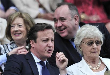 Britain's Prime Minister David Cameron (L) sits on Centre Court for the men's singles final tennis match between Roger Federer of Switzerland and Andy Murray of Britain at the Wimbledon Tennis Championships in London July 8, 2012. REUTERS/Toby Melville