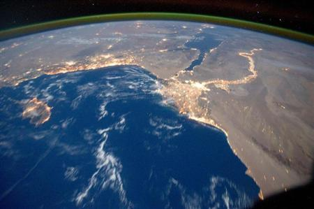 Earth's airglow is seen with an oblique view of the Mediterranean Sea area, including the Nile River with its delta and the Sinai Peninsula, in this October 15, 2011 NASA handout photograph taken by a crew member of Expedition 29 aboard the International Space Station. REUTERS/NASA/Handout