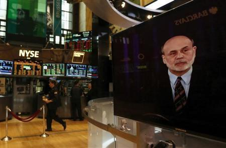 A press conference by Federal Reserve Chairman Ben Bernanke is seen on a television on the floor of the New York Stock Exchange, March 20, 2013. REUTERS/Brendan McDermid