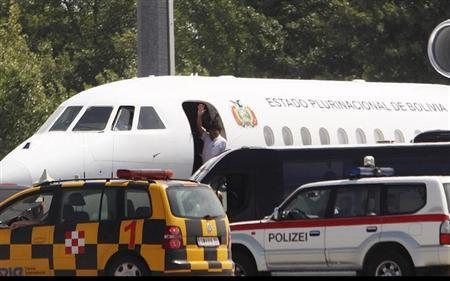 Bolivian President Evo Morales waves from his plane before leaving the Vienna International Airport in Schwechat July 3, 2013. REUTERS/Heinz-Peter Bader