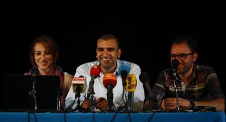 Mohamed Bennour (C), coordinator of the Tunisia Tamarod (rebel) movement, speaks at a news conference in Tunis July 3, 2013. REUTERS/Zoubeir Souissi