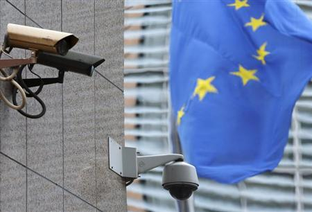 Security cameras are seen near the main entrance of the European Union Council building in Brussels July 1, 2013. REUTERS/Francois Lenoir