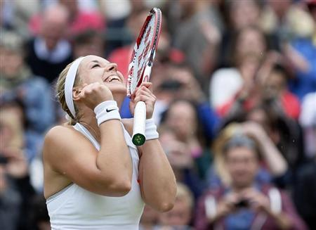 Sabine Lisicki of Germany celebrates after defeating Kaia Kanepi of Estonia in their women's quarter-final tennis match at the Wimbledon Tennis Championships, in London July 2, 2013. REUTERS/Stefan Wermuth