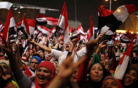 Protesters, who are against Egyptian President Mohamed Mursi, react in Tahrir Square in Cairo July 3, 2013. REUTERS/Suhaib Salem