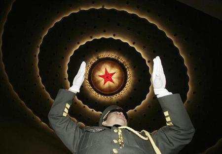 The conductor of a military band performs during the rehearsal ahead of the opening ceremony of the Chinese People's Political Consultative Conference (CPPCC) at the Great Hall of the People in Beijing March 3, 2010. REUTERS/Jason Lee