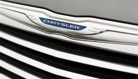 A Chrysler badge is pictured on a new car at a dealership in Vienna, Virginia April 26, 2012. REUTERS/Kevin Lamarque