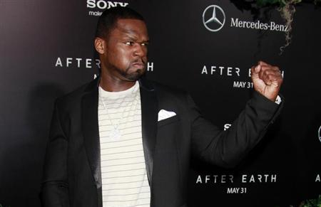 Rapper Curtis ''50 Cent'' Jackson jokingly makes a fist as he arrives for the premiere of the film ''After Earth'' in New York May 29, 2013. REUTERS/Carlo Allegri
