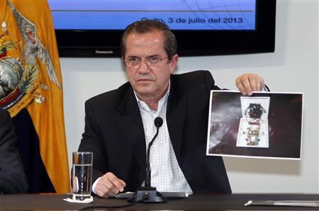 Ecuador's Foreign Minister Ricardo Patino shows a picture of a hidden spy microphone uncovered at the office of Ana Alban, the Ecuadorean ambassador to the United Kingdom, during a news conference in Quito, July 3, 2013. REUTERS/Gary Granja