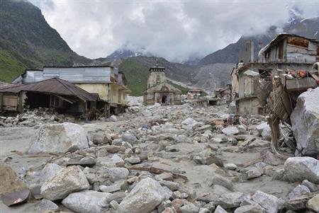 The Kedarnath Temple (C) is pictured amid damaged surroundings by flood waters at Rudraprayag in Uttarakhand June 20, 2013. REUTERS/Stringer/Files