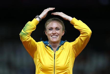 Australia's Sally Pearson reacts on the podium before being presented with the gold medal for the women's 100m hurdles at the London 2012 Olympic Games in London at the Olympic Stadium August 8, 2012. REUTERS/Eddie Keogh