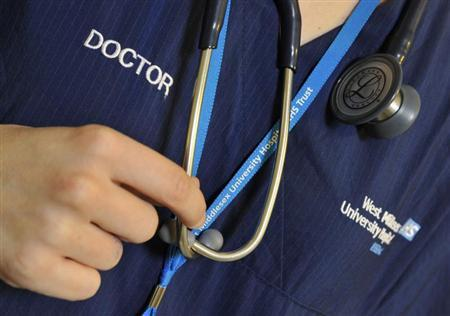A doctor holds her stethoscope in an outpatients ward at a hospital in west London April 4, 2011. REUTERS/Toby Melville