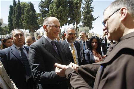 Italy's Prime Minister Enrico Letta (C) shakes hands with a priest during his visit to the Church of the Nativity, revered as the site of Jesus' birth, in the West Bank town of Bethlehem July 2, 2013. REUTERS/Mohamad Torokman