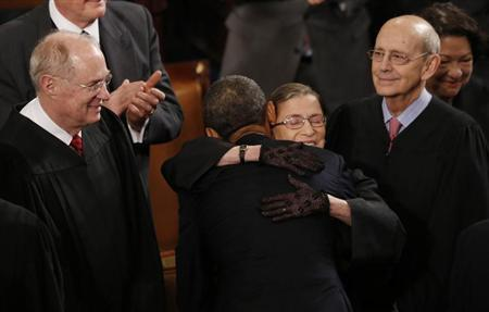 U.S. Supreme Court Justice Ruth Bader Ginsburg hugs President Barack Obama as fellow Supreme Court Justices Anthony Kennedy (L) and Stephen Breyer (R) look on as the President arrives to deliver his State of the Union speech on Capitol Hill in Washington, February 12, 2013. REUTERS/Jason Reed