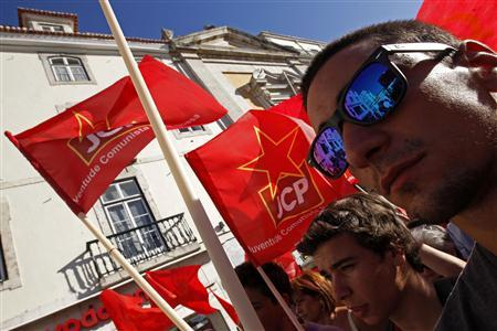 Communist Party members march during a protest calling for a government resignation in Lisbon July 3, 2013. REUTERS/Jose Manuel Ribeiro