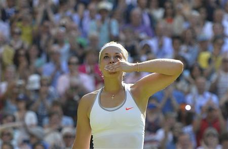 Sabine Lisicki of Germany celebrates after defeating Agnieszka Radwanska of Poland in their women's semi-final tennis match at the Wimbledon Tennis Championships, in London July 4, 2013. REUTERS/Toby Melville