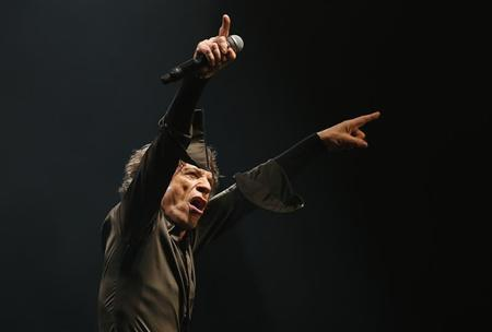 Lead singer of the Rolling Stones Mick Jagger performs on the Pyramid Stage at Glastonbury music festival at Worthy Farm in Somerset, June 29, 2013. REUTERS/Olivia Harris