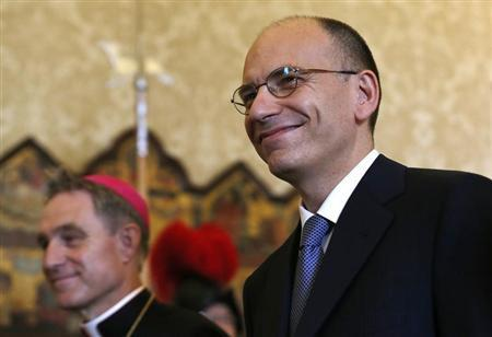 Italy's Prime Minister Enrico Letta (R) arrives to meet Pope Francis as he is flanked by father Georg Gaenswein during a meeting at the Vatican July 4, 2013. REUTERS/Alessandro Bianchi