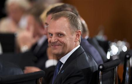 Polish Prime Minister Donald Tusk waits at the start of the conference of European leaders on the fight against mass youth unemployment in Europe, July 3, 2013 at the Chancellery in Berlin. REUTERS/Johannes Eisele/Pool