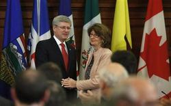 Canada's Prime Minister Stephen Harper (L) shakes hands with Government Leader in the Senate Marjory LeBreton after delivering a speech during a Conservative caucus meeting on Parliament Hill in Ottawa May 21, 2013. REUTERS/Chris Wattie