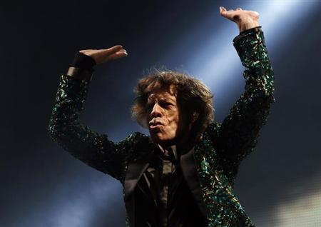 Mick Jagger of the Rolling Stones performs on the Pyramid Stage at Glastonbury music festival at Worthy Farm in Somerset, June 29, 2013. REUTERS/Olivia Harris