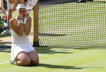 Sabine Lisicki of Germany celebrates after defeating Agnieszka Radwanska of Poland in their women's semi-final tennis match at the Wimbledon Tennis Championships, in London July 4, 2013. REUTERS/Suzanne Plunkett