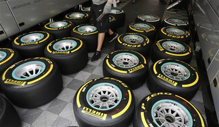 Pirelli tyres of Germany's Mercedes Formula One driver Nico Rosberg are checked at the Nuerburgring July 4, 2013. The German F1 Grand Prix will be held at the Nuerburgring racing circuit on Sunday. REUTERS/Wolfgang Rattay