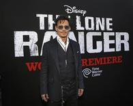 "Cast member Johnny Depp poses at the world premiere of ""The Lone Ranger"" at Disney California Adventure Park in Anaheim, California in this June 22, 2013, file photo. ""The Lone Ranger,"" Walt Disney Co's big-budget western starring Depp, performed below expectations on Wednesday night, raising the possibility that the movie could saddle the media giant with a loss on the film. REUTERS/Mario Anzuoni/Files"