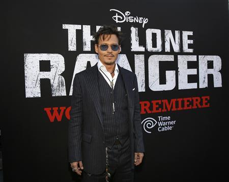 Cast member Johnny Depp poses at the world premiere of ''The Lone Ranger'' at Disney California Adventure Park in Anaheim, California in this June 22, 2013, file photo. ''The Lone Ranger,'' Walt Disney Co's big-budget western starring Depp, performed below expectations on Wednesday night, raising the possibility that the movie could saddle the media giant with a loss on the film. REUTERS/Mario Anzuoni/Files