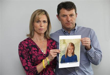 Kate and Gerry McCann pose with a computer generated image of how their missing daughter Madeleine might look now, during a news conference in London May 2, 2012 file photo. REUTERS/Andrew Winning
