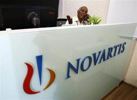 A man speaks on a telephone inside Novartis India headquarters in Mumbai April 1, 2013. REUTERS/Vivek Prakash