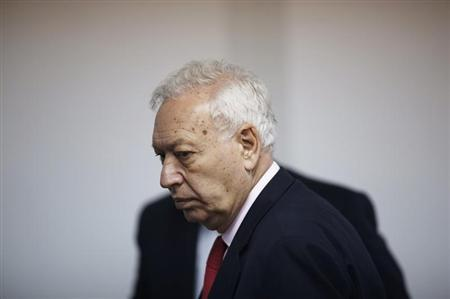 Spanish Foreign Minister Jose Manuel Garcia-Margallo walks before a joint news conference with his Palestinian counterpart Riyad al-Malki in the West Bank city of Ramallah April 22, 2013. REUTERS/Mohamad Torokman