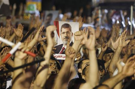 Members of the Muslim Brotherhood and supporter of ousted Egyptian President Mohamed Mursi shouts slogans at the Raba El-Adwyia mosque square in Cairo July 4, 2013. REUTERS/Louafi Larbi
